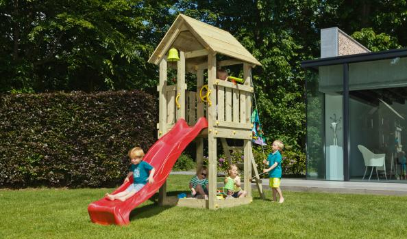wooden blue rabbit playtower with boy on slide and hoisting flag