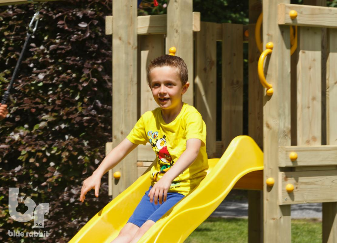 wooden blue rabbit playtower with boy on on yellow slide
