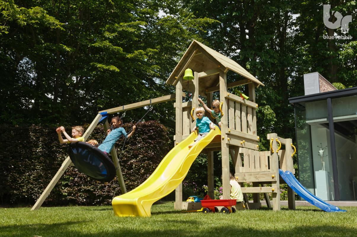 wooden blue rabbit playtower with boy on yellow slide with addon swing and extra platform