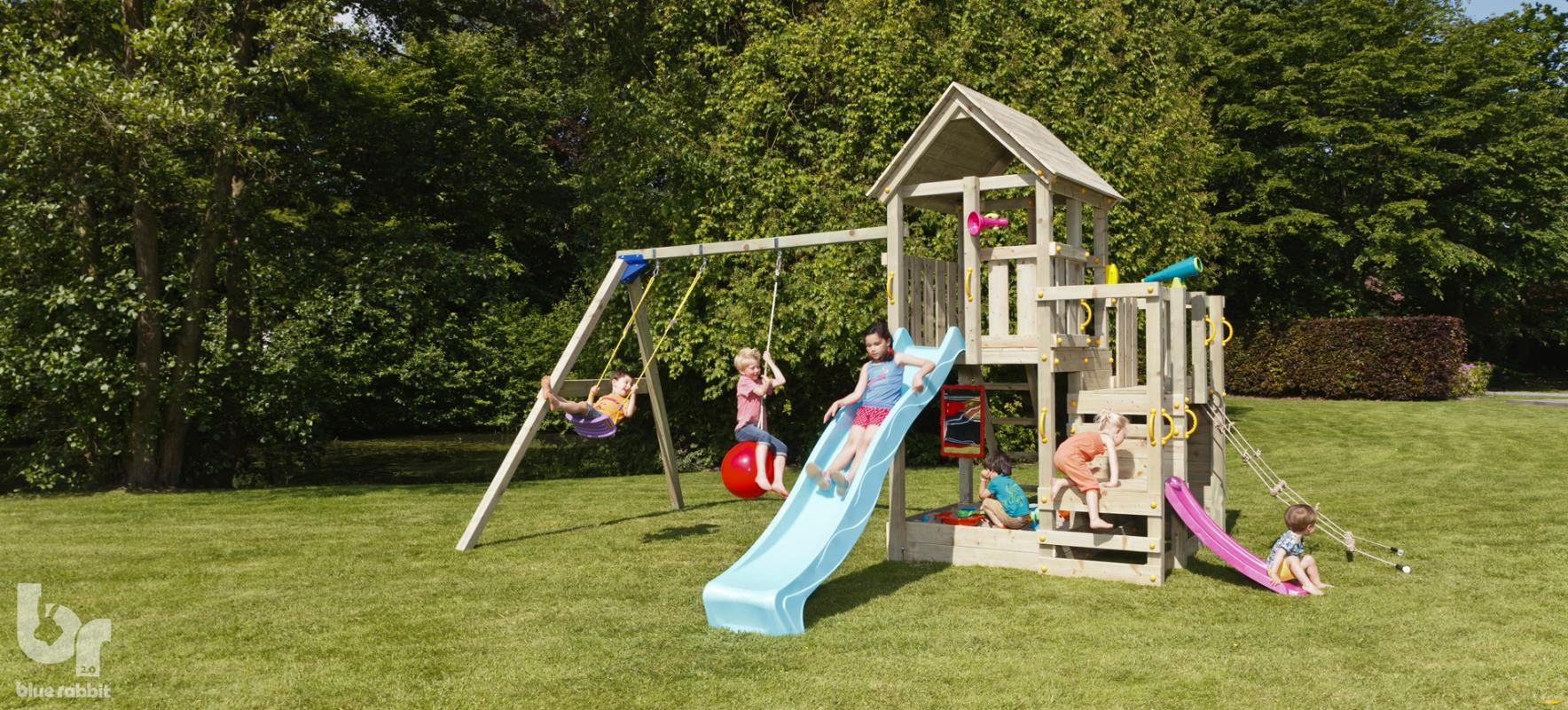 wooden blue rabbit playtower penthouse with girl on turquoise blue slide and addon swing
