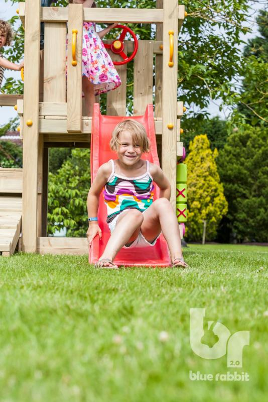 wooden Blue Rabbit playtower cascade with girl on slide smiling